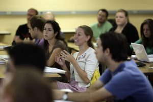 CHRIS MEYER/INDIANA UNIVERSITY -- Becky Schrier makes a point during a discussion of economic development in Barry Rubin's class.